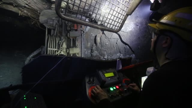 a worker uses a drilling machine to excavate copper ore in an underground tunnel at the taymyrsky copper mine operated by mmc norilsk nickel pjsc in... - five cent coin stock videos & royalty-free footage