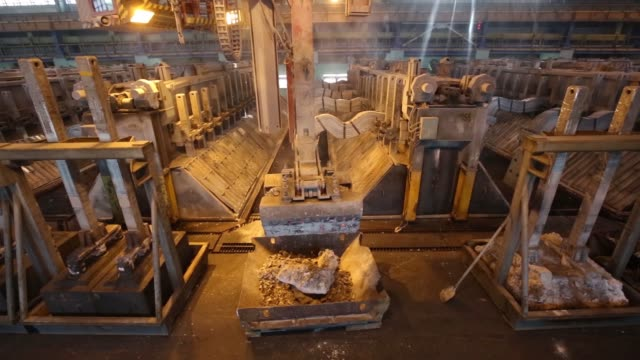 A worker uses a gantry crane to prepare an electroysis bath electrolysis shop at the Irkutsk aluminium smelter operated by United Co Rusal in...