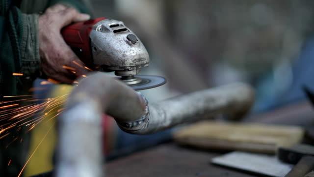 worker uses a grinder