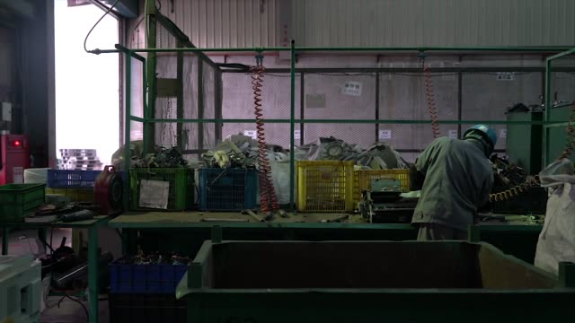 a worker uses a hammer to dismantle a printer at the super dragon technology co e waste processing facility in taoyuan taiwan on wednesday jan 13 2016 - e waste stock videos & royalty-free footage