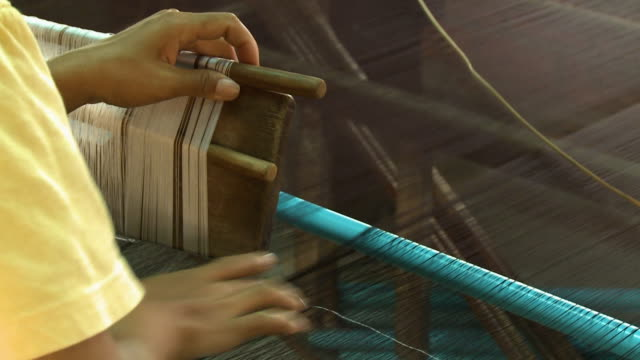 a worker using a loom for weaving silk threads - obsessive stock videos & royalty-free footage