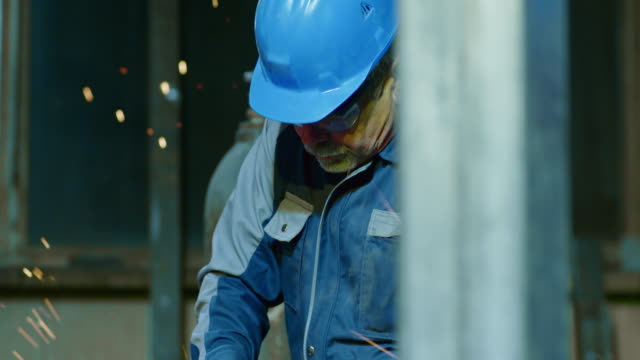 SLO MO TU Worker using an angle grinder