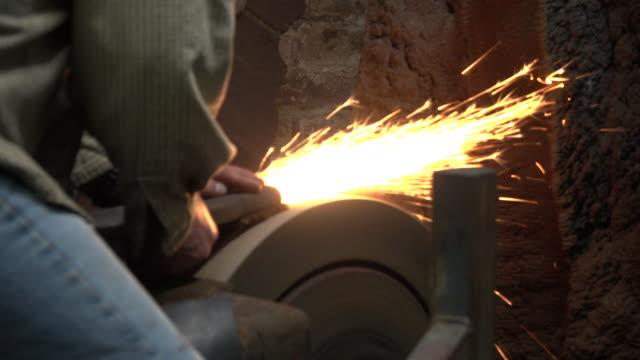 Worker using grinding stone wheel