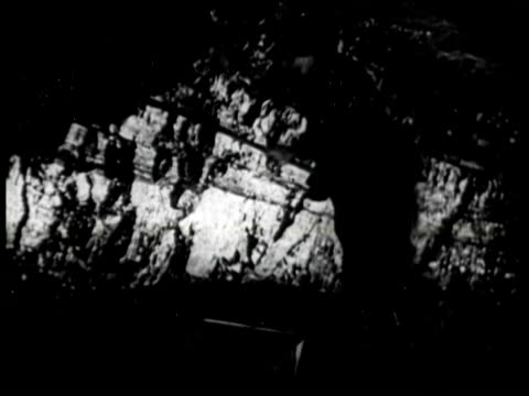 b/w ms worker using hand tool in coal mine, united states / audio - coal miner stock videos & royalty-free footage