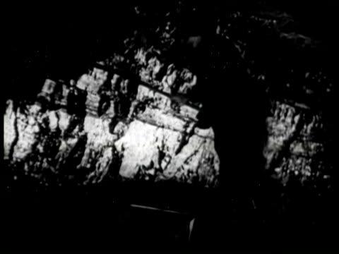 b/w ms worker using hand tool in coal mine, united states / audio - kohlenbergmann stock-videos und b-roll-filmmaterial