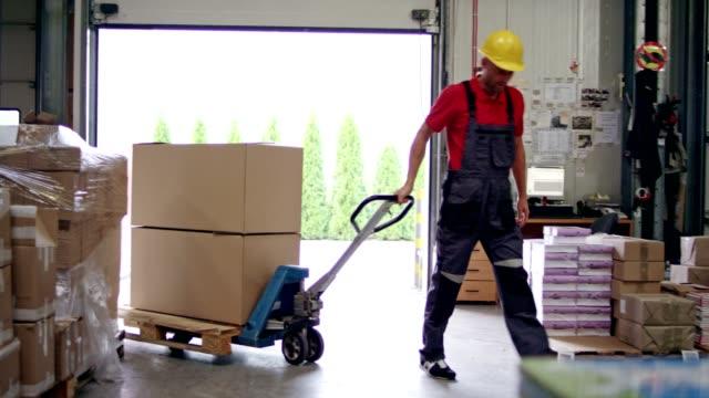 Worker using pallet jack