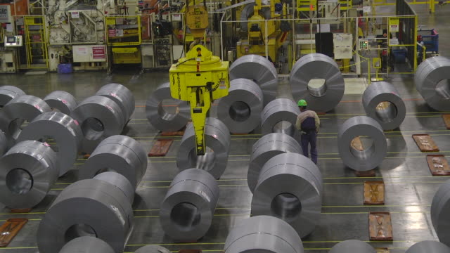 ms tu worker using remote controlled crane through moving coil of steel in an auto assembly plant warehouse / princeton, indiana, united states - curled up stock videos and b-roll footage