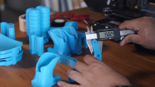 worker using vernier calliper for measuring scale of 3d printed part - calliper stock videos & royalty-free footage