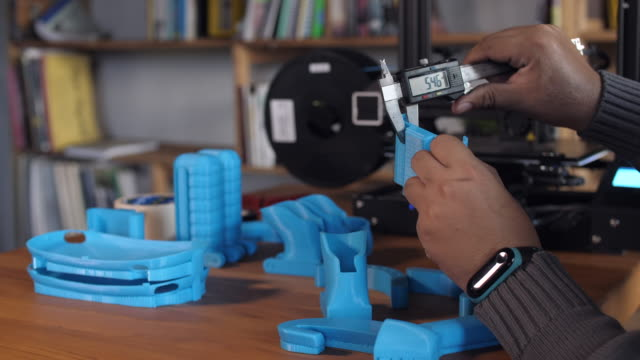 worker using vernier calliper for measuring scale of 3d printed part - vernier calliper stock videos & royalty-free footage