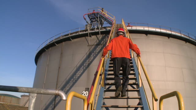 WS Worker walking up stairs at Holborn Refinery / Hamburg, Germany
