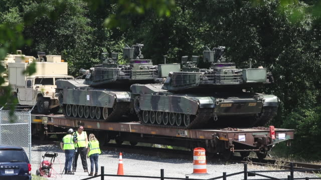 a worker washes one of two m1a1 abrams tanks that are loaded on flatbed rail cars at a csx railyard on july 2 2019 in washington dc president trump... - fourth of july stock videos & royalty-free footage