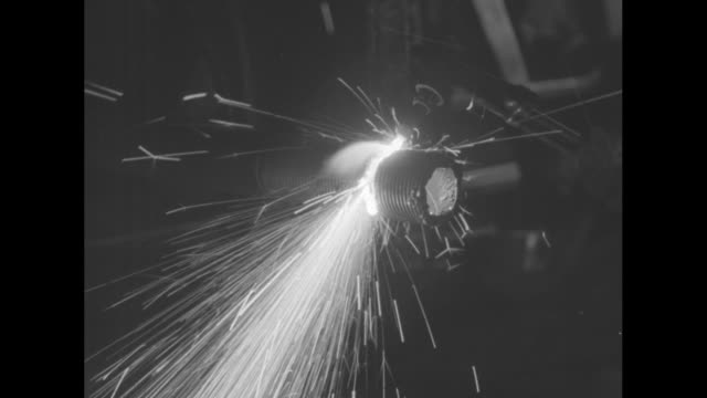 worker wearing safety goggles using blow torch to shorten pipe extending from heavy machinery, workers in bg / closer shot man using blow torch,... - cut video transition stock videos & royalty-free footage