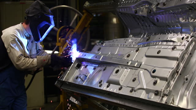 ms worker welding on car body  - regensburg stock videos & royalty-free footage