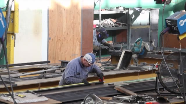 a worker welds a steel girder at the international hitech industries facility in delta british columbia canada on tuesday nov 12 2013 canada workers... - girder stock videos & royalty-free footage