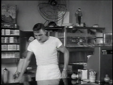 vidéos et rushes de 1946 montage worker wiping down a store counter / usa - 1946