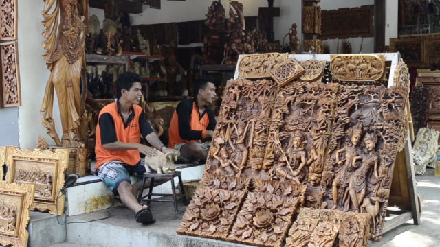 ms worker wood carving souvenirs at shop / tanah lot, bali, indonesia - craft product stock videos and b-roll footage