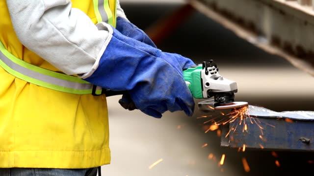 Worker work with grinder.