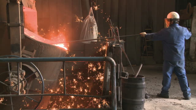 ms  worker working at inductive heating furnace of foundry / juenkerath, rhineland-palatinate, germany  - foundry worker stock videos and b-roll footage