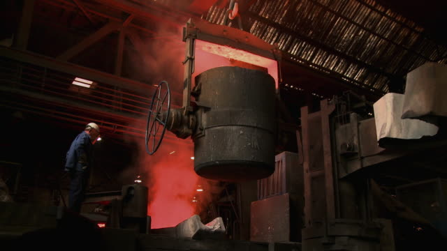ws zi  worker working at inductive heating furnace of foundry / juenkerath, rhineland-palatinate, germany  - foundry worker stock videos and b-roll footage
