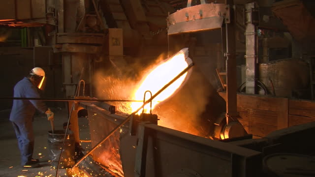 ms worker working at production hall of foundry / juenkerath, rhineland-palatinate, germany  - foundry worker stock videos and b-roll footage
