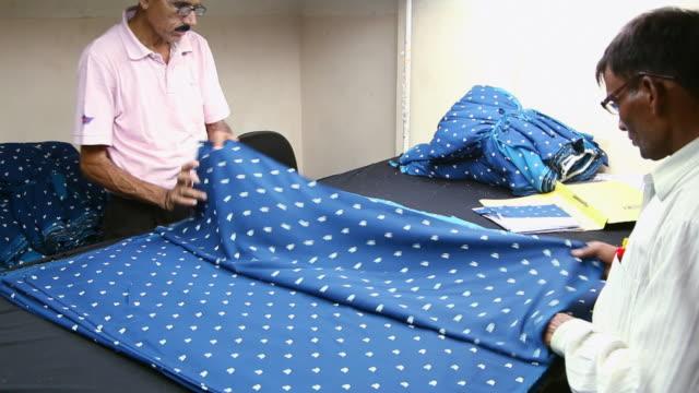 Worker working in a cloth mill, Noida, Uttar Pradesh, India