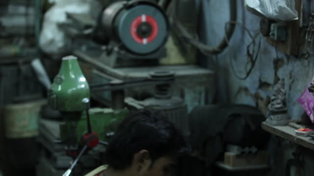 Worker working in a factory, Delhi, India