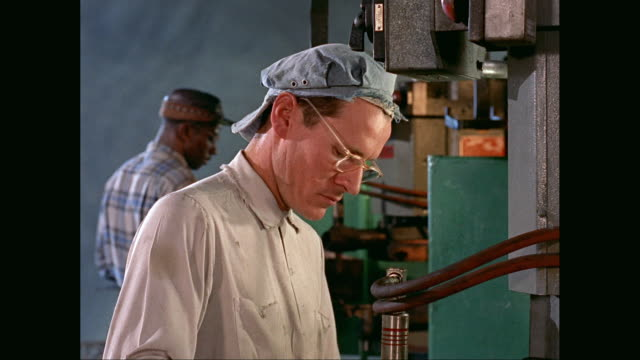 vídeos de stock, filmes e b-roll de ms worker working in factory / united states - 1960