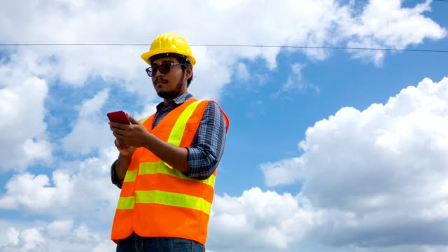 hd : worker working under electric tower. - hard hat stock videos & royalty-free footage