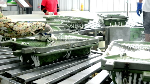 worker working with metal mold on conveyor belt in factory - latex stock videos & royalty-free footage