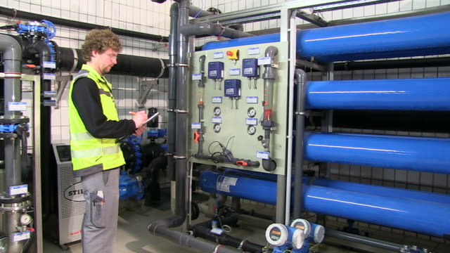 ms pan worker writing status of decalcifying plant at water works / konz, rhineland-palatinate, germany - sewage treatment plant stock videos & royalty-free footage
