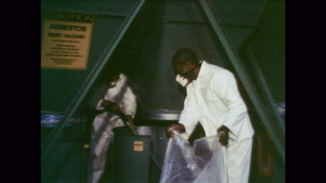 1978 workers and equipment operate in a clean asbestos plant - asbest stock-videos und b-roll-filmmaterial