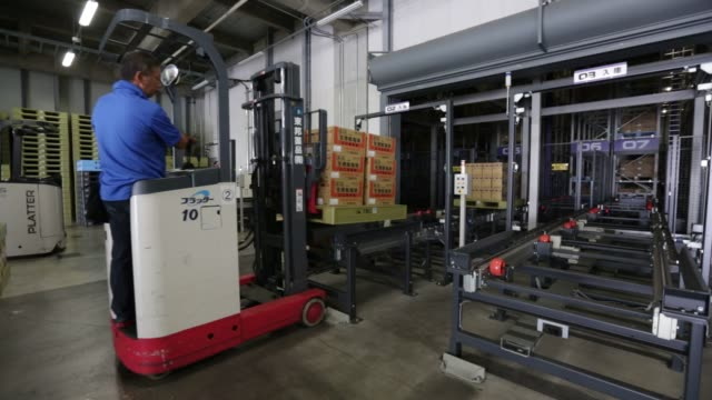 workers and industrial robots sort through packages at a distribution center, operated by toho pharmaceutical co, toho holdings cos pharmaceutical... - medical supplies stock videos & royalty-free footage
