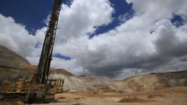 Workers and machines move through the Yanacocha gold mine located in northern Peru on October 26th 2015 Shots Drilling machines make holes for...