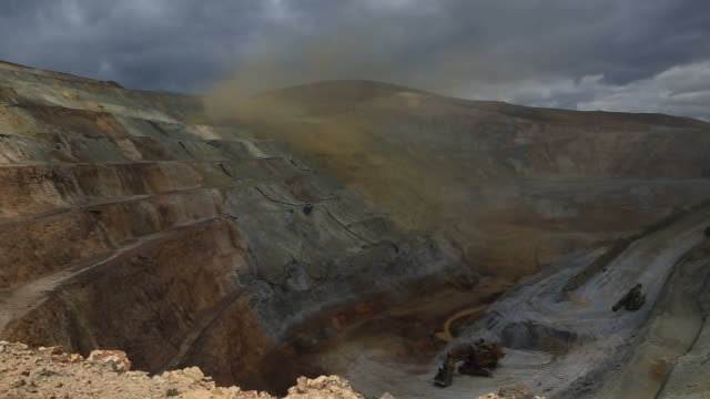 workers and machines move through the yanacocha gold mine located in northern peru on october 26th 2015 shots personnel and machines read a field for... - peru stock videos & royalty-free footage