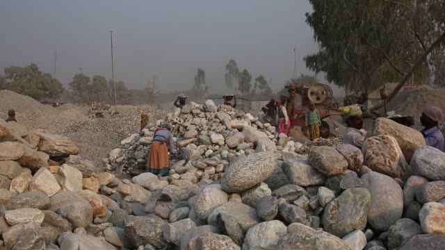 vídeos de stock, filmes e b-roll de workers are busy with stone crushing in bangladesh lots of stones are imported from different countries to meet the demand of stone a lot of stone... - estilo de vida insalubre