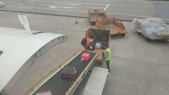 workers are carrying luggage in airport - luggage stock videos & royalty-free footage