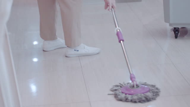workers are cleaning with mops to prevent the wind. - flooring stock videos & royalty-free footage
