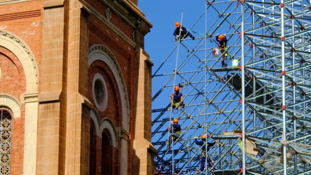 workers are maintaining the notre-dame cathedral basilica of saigon - construction worker stock videos & royalty-free footage