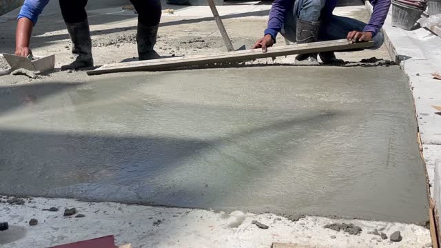 workers are pouring mortar and plastering the floor. - vignettierung stock-videos und b-roll-filmmaterial