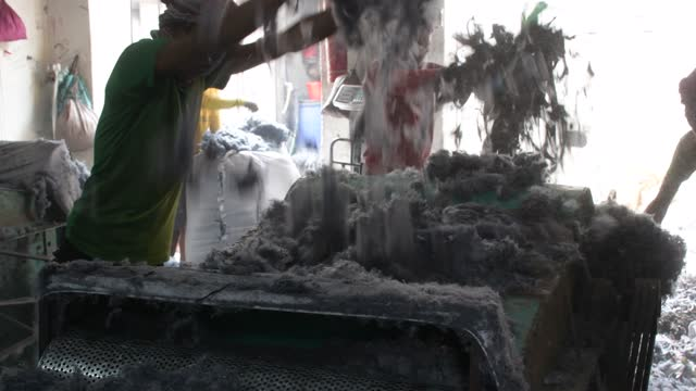 workers are producing cotton with abandoned pieces of cloth from the garment factory by using a machine in gazipur on the outskirts of dhaka,... - clothing stock videos & royalty-free footage