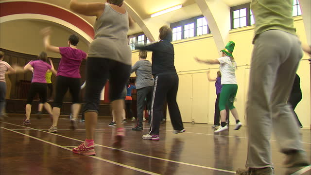 stockvideo's en b-roll-footage met workers are to be offered counselling physiotherapy zumba classes in a bid to cut the number of days people take off sick showing zumba class people... - bod
