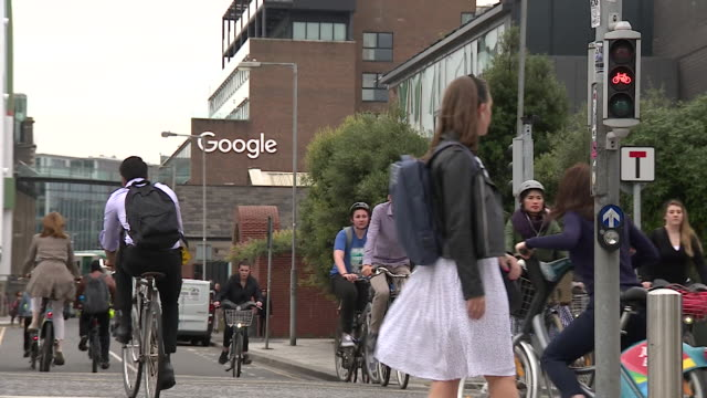 workers arriving on bicycle at google offices in dublic republic of ireland - office stock videos & royalty-free footage