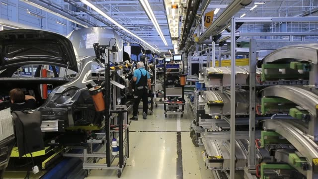 workers assemble an sclass sedan at the mercedesbenz plant on january 24 2018 in sindelfingen germany daimler ag which owns the mercedesbenz brand... - mercedes benz stock videos & royalty-free footage
