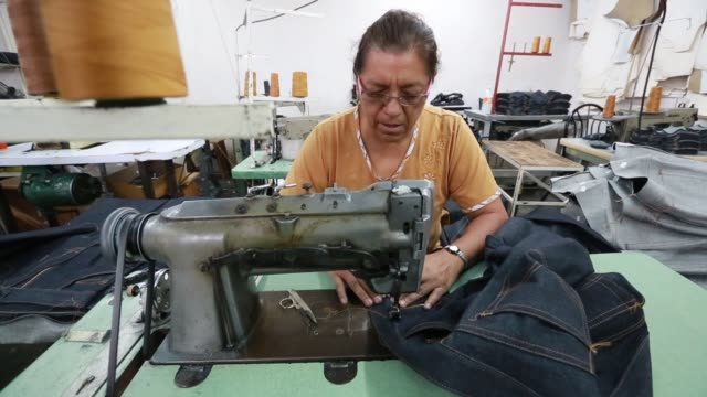 workers assemble and sew the jeans cloth to make jeans inside a small jeans factory in san pedro coahuilaon mexico on september 25 close up shotf of... - jeans stock videos & royalty-free footage