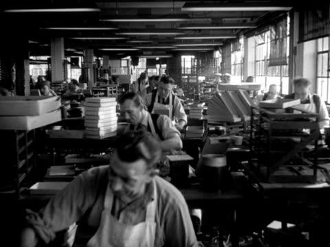 workers assemble charity poppies in the royal british legion poppy factory. - manual worker stock videos & royalty-free footage