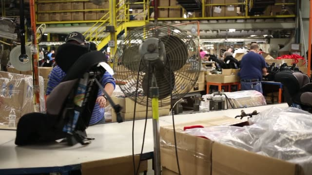 workers assemble child car seats at the dorel juvenile group factory in columbus indiana us on tuesday march 25 close up of a worker assembling bolts... - columbus indiana stock videos & royalty-free footage