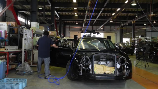 workers assemble parts of mitsuoka motors co automobiles at the company's factory in toyama japan on tuesday july 12 a worker adds rubber piping... - crimped hair stock videos and b-roll footage