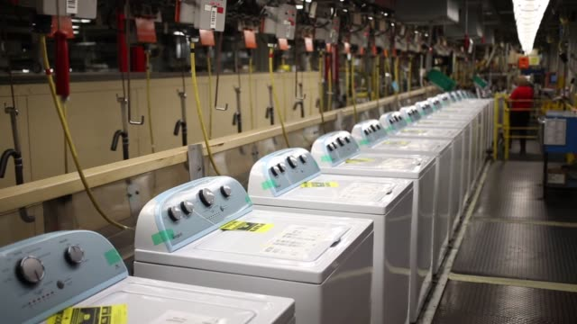 Workers assemble washing machines at the Whirlpool Corp Maytag plant in Clyde Ohio US on Wed December 9 2015 Photographer Luke Sharrett Bloomberg...