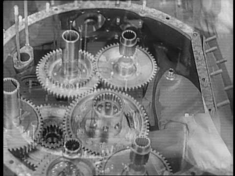 workers assembling engines inside aviation plant / close up of engine being constructed / worker placing part of engine block / close up of hands... - plant part stock videos and b-roll footage