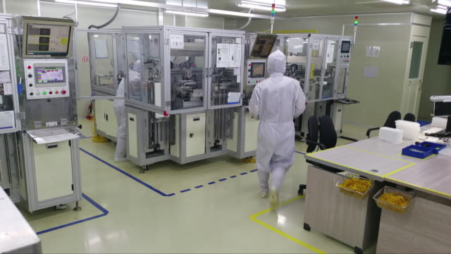 workers at a contact lens manufacturing factory - contact lens stock videos and b-roll footage